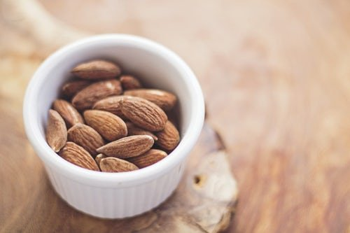 small-white-ceramic-bowl-filled-with-whole-almonds
